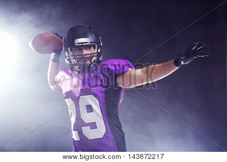American football player on smoky background