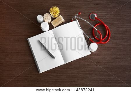 Medical equipment on wooden table, top view