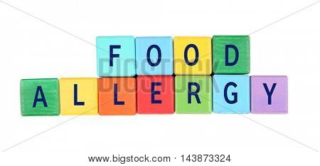 Allergy danger concept. Colorful blocks with text food allergy on white background.