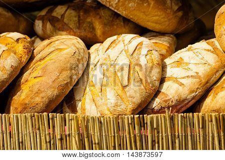 Many Brown Rustic Fresh Rye Bread Loaves