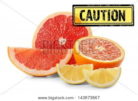 Allergy danger concept. Different citrus slices with stamp caution on white background.
