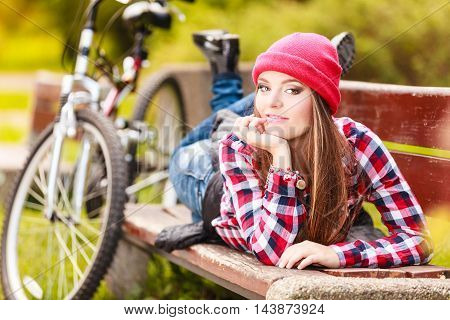 Fall active lifestyle concept. Beauty young woman sporty casual girl relaxing in autumnal park with bicycle outdoor