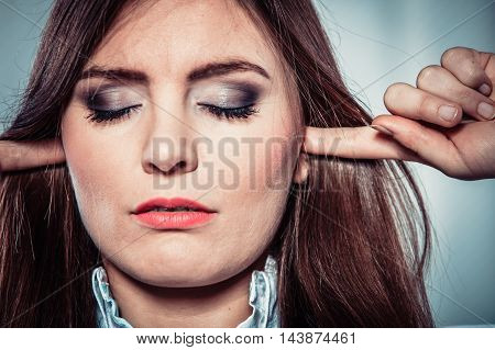 Stressed Woman With Closed Eyes Put Fingers In Ears,