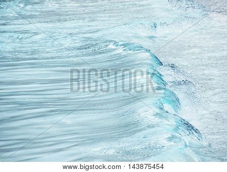 Fresh Water Abstract showing movement in the form of a wave and clear blue refreshing colors shot out side on a summers day for a background banner copy space and events
