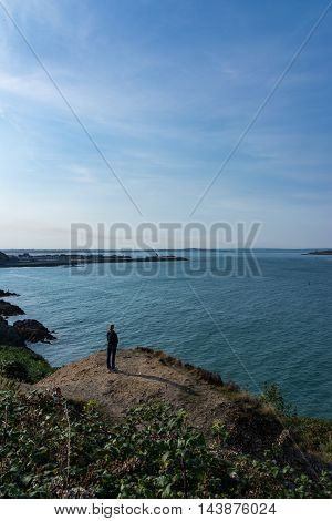 Woman On Cliff Howth Harbor Ireland Ocean Human Small Perspective