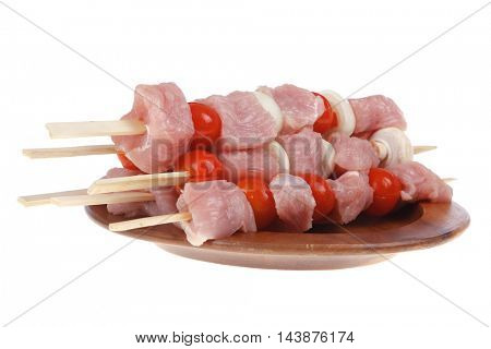 fresh raw meat fillet shish kebab turkey pork pink on skewers tomatoes mushrooms on wooden dish isolated over white background