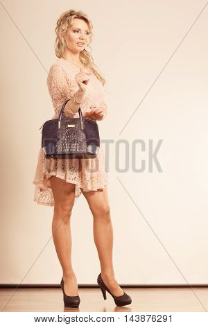 Pretty Woman With Black Handbag.