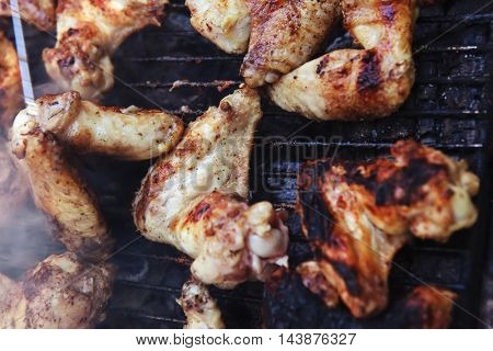 fresh roast chicken wings over bbq grid