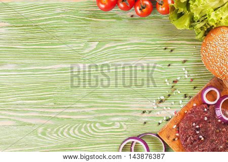 Pasta ingridients and spice on green wooden surface. Top view.