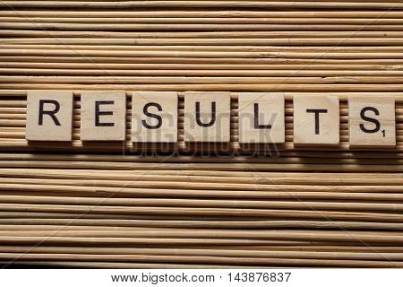 RESULTS word written on wood abc block.
