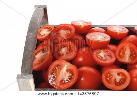 old style antique grey box full of fresh red raw tomatoes and halfs isolated over white background