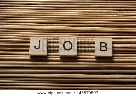 Cubes with the word job on wooden table.
