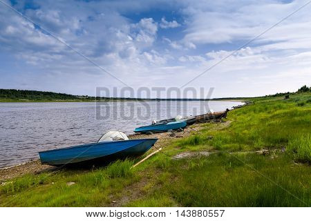 Boats on the river bank of the North Dvina