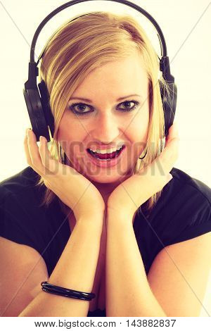 Blonde Girl In Big Headphones.
