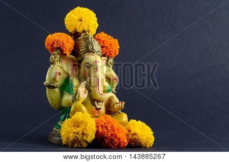 Hindu God Ganesha. Ganesha Idol on dark Background.