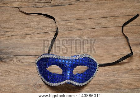 A mask displayed on a wooden background