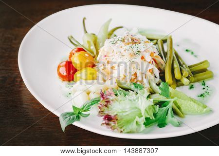 Vegetables salad with cabbage tomatoes onion chili garlic and herbs