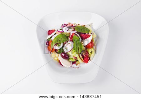 Vegetables with goat cheese and kalamata olives strawberry onion on white background