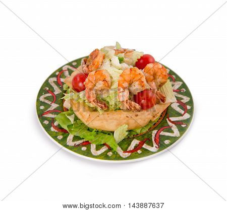 Mexican style of salads with shrimps salmon lemon and lettuce on white background