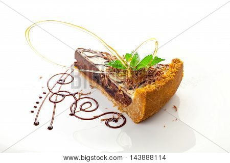 Chocolate cake with mint leaf on white background