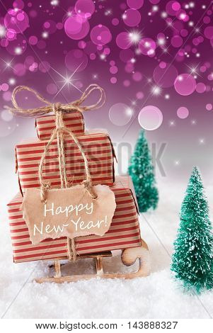 Vertical Image Of Sleigh Or Sled With Christmas Gifts Or Presents. Snowy Scenery With Snow And Trees. Purple Sparkling Background With Bokeh. Label With English Text Happy New Year