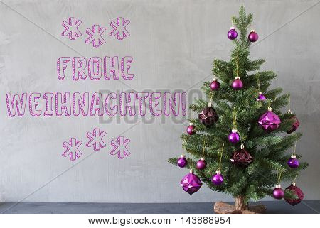 Christmas Tree With Purple Christmas Tree Balls. Card For Seasons Greetings. Gray Cement Or Concrete Wall For Urban, Modern Industrial Styl. German Text Frohe Weihnachten Means Merry Christmas