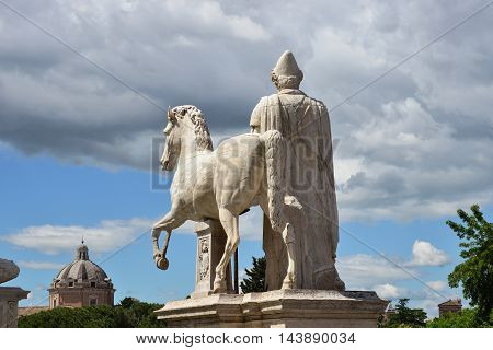 Ancient roman statue of Dioskouri against cloudy sky on Capitol Hill in Rome