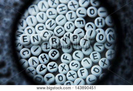 Decrypting encrypted or encoded data, concept image. Inspecting or magnifying encoded data. Random alphabets with letters of