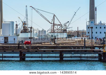 Loading Or Discharging Tower Crane At A Sea Port