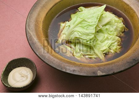 Sweet and fresh spring cabbage as flower petals pork to wine pork in traditional stew with sauce