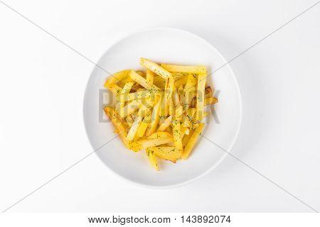 Fried crispy potatoes on white plate background