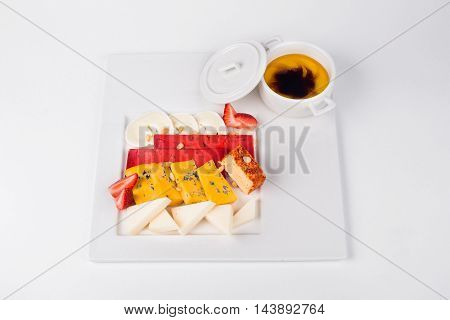 Cheese with strawberries and nuts on white plate background