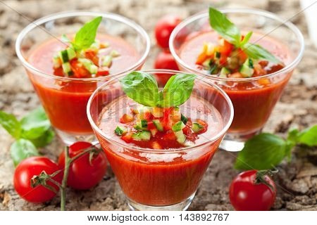 Tomato juices in glasses with herbs in restaurant