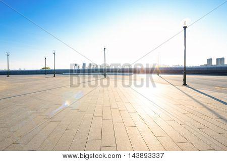 empty city square in harbin with sunbeam