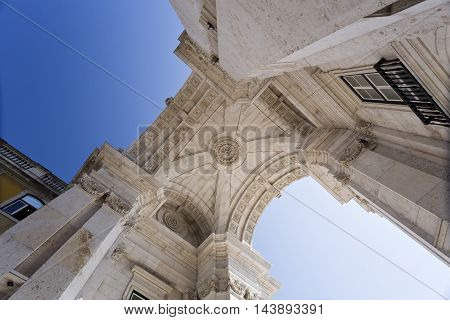 Upwards view of the Rua Augusta Arch a stone triumphal arch-like historical building and main attraction on the Praca do Comercio in Lisbon Portugal