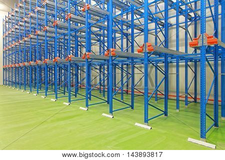 New Blue Shelves in Empty Distribution Warehouse