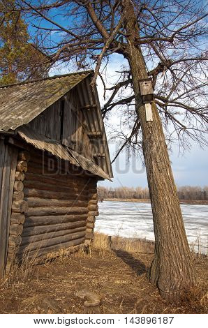The Old Hut. Birdhouse In A Tree. River Ice