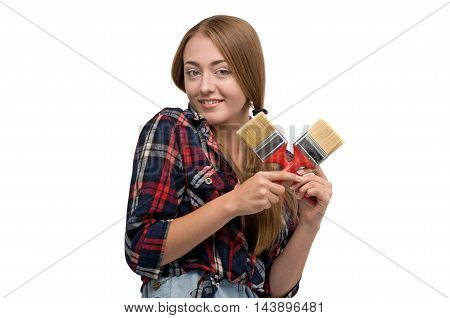 woman holding a paint brush and paint roller