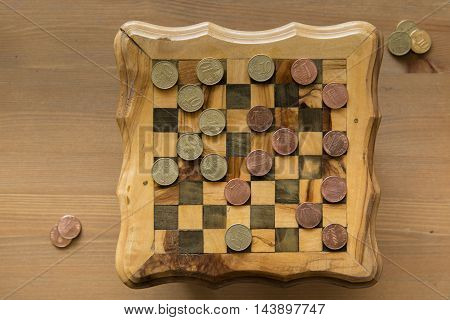 game of checkers - US cents VS euro cents
