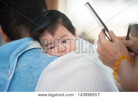Baby first time hair cut in the barber