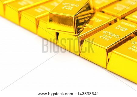 pieces of gold bars on white with copy space