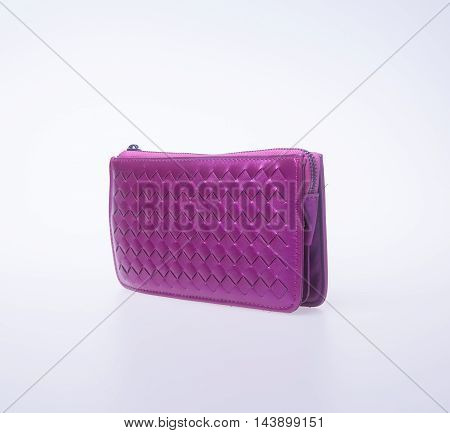 Wallet Or Purse Woman (purple Colour) On A Background.