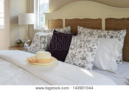 Vintage Bedroom Interior With Flower Pillows And Decorative Tabl