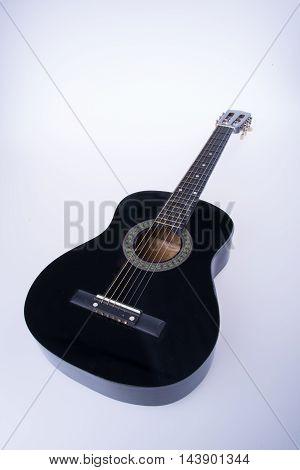 Guitars Or Black Color Guitars On A Background.
