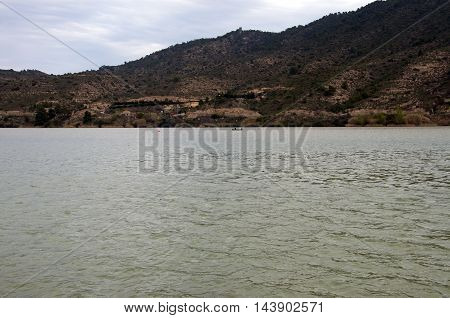 Boat with two fishermen in the Mequinenza Reservoir