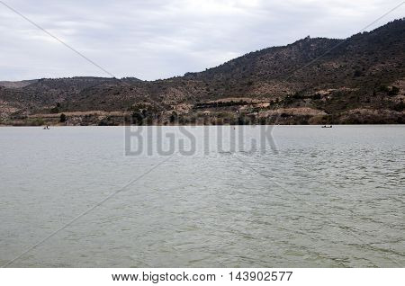 Some boats fishing in the Mequinenza Reservoir