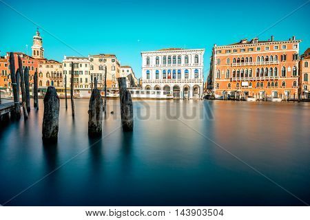 Venice cityscape view on Grand canal with colorful buildings and boats. Long exposure image technic with glossy water.