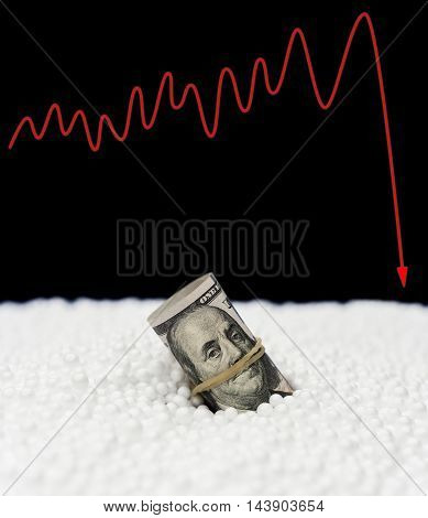 USD paper currency sink into polystyrene particle and a fluctuation graphic on background monetary concept