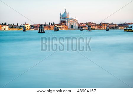 Sunset view on La Giudecca island with basilica del Redentore on the sunset in Venice. General plan with copy space
