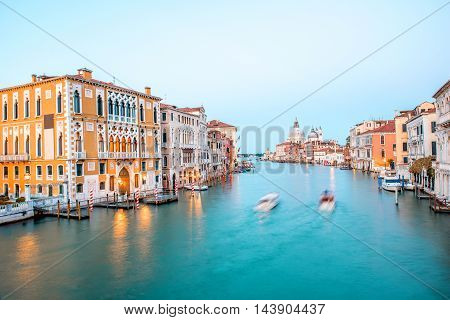 View on illuminated Grand canal with Santa Maria basilica from Accademic bridge at the dusk in Venice. Long exposure image technic